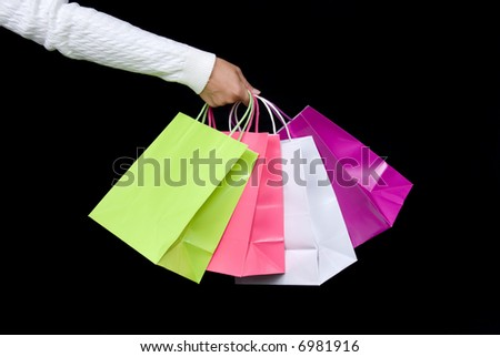 Shopping bag assortment waiting to be filled with holiday gifts or Valentine's delights - stock photo