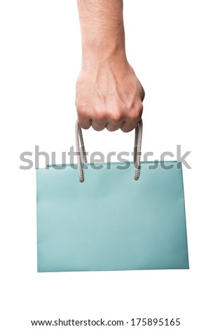 Shopping bag in hand - stock photo
