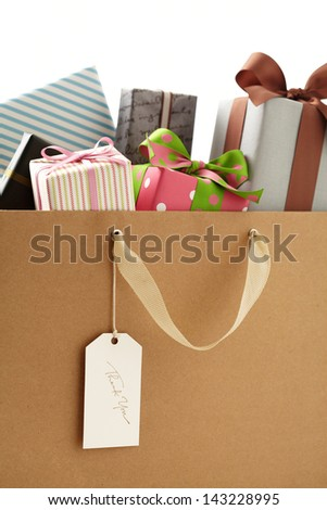 Shopping Bag of presents on white background.  brown Shopping bag.  - stock photo