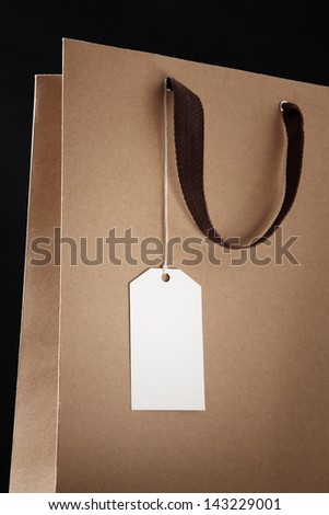 Shopping bag on black background.  brown Shopping bag. Close-up. - stock photo