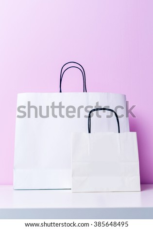 Shopping bag on lilac background