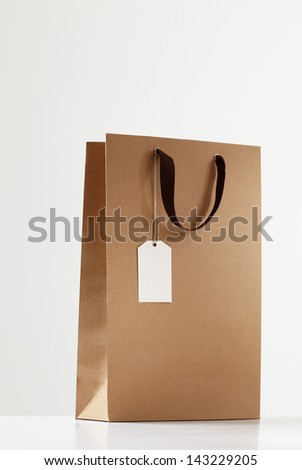 Shopping bag on white table.  brown Shopping bag - stock photo