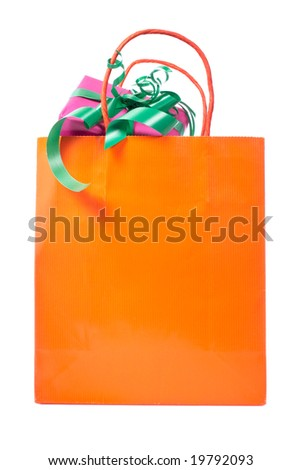 Shopping bag with gifts inside, isolated on white background - stock photo