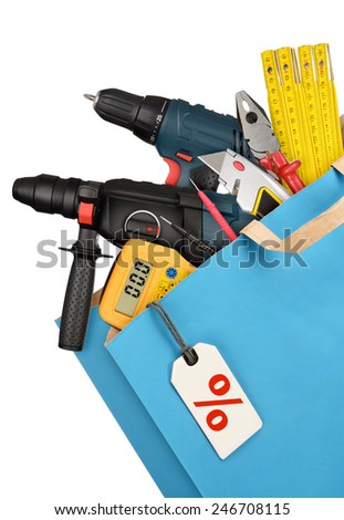 Shopping bag with work tools isolated on white background - stock photo