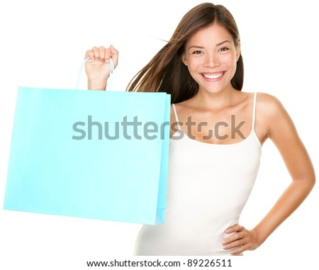 Shopping bag woman. Beautiful smiling happy woman holding showing blue shopping bag isolated on white background. Fresh multiracial Asian Caucasian female model.