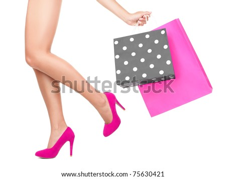 Shopping bag woman - shopper concept. Closeup of woman legs and shopping bags- Isolated on white background.