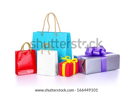 Shopping bags and colorful gift boxes with bows, isolated on white  - stock photo