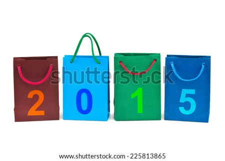 Shopping bags and numbers 2015 isolated on white background - stock photo