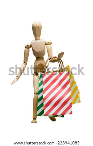 Shopping bags being carried by a mannequin, isolated on white - stock photo