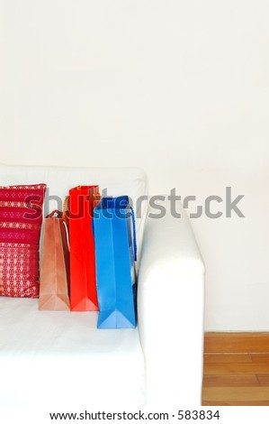 shopping bags in a minimalist apartment (high key) - stock photo