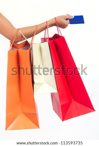 shopping bags set  and credit card in woman's hand isolated on white - stock photo