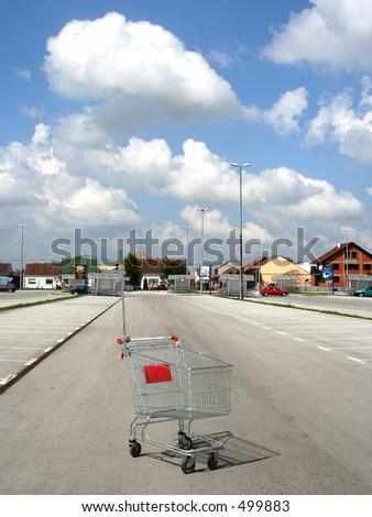 shopping basket against beautiful sky - stock photo