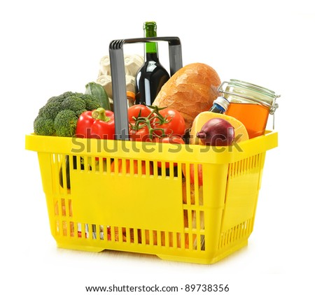 Shopping basket and groceries isolated on white - stock photo