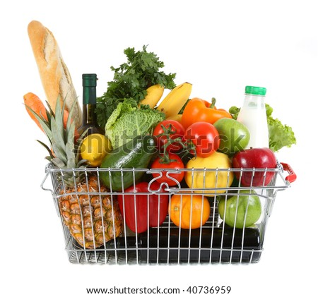 Shopping basket filled with fresh fruit and vegetables - stock photo