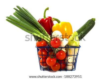Shopping basket filled with vegetables isolated over white - stock photo