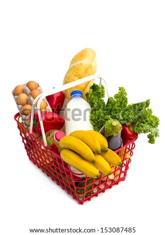 shopping basket full of fresh colorful vegetables,  isolated on white background. - stock photo