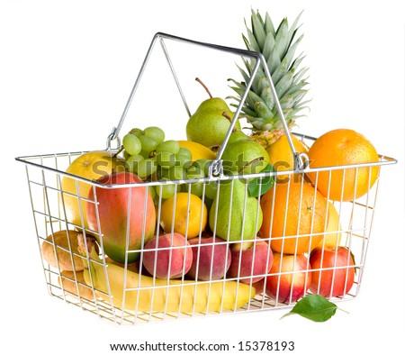 Shopping basket full of fresh fruit isolated on white background. - stock photo