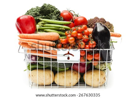 Shopping basket with assortment of vegetables on white background - stock photo