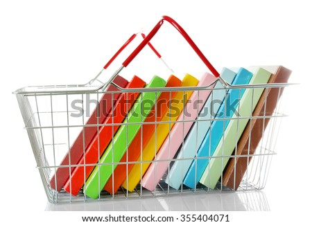 Shopping basket with books isolated on white - stock photo