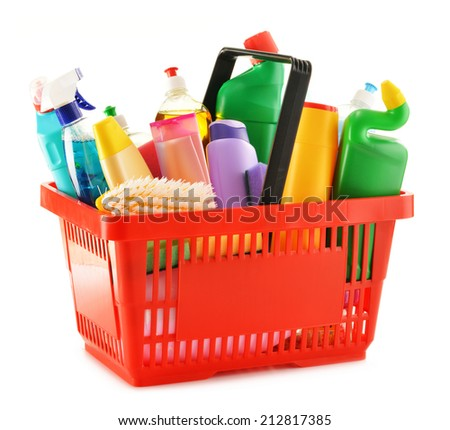 Shopping basket with detergent bottles and chemical cleaning supplies isolated on white - stock photo