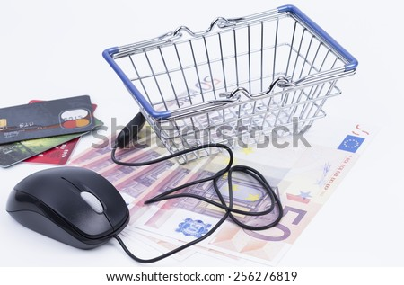 Shopping basket with mouse and banknotes isolated on white background - stock photo