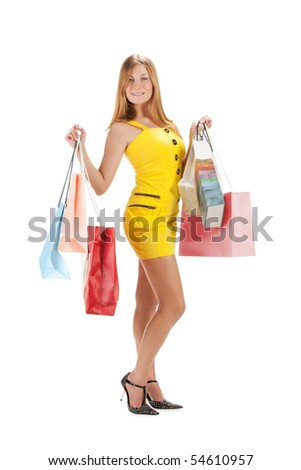 Shopping. Beautiful girl with bag isolated on white background.