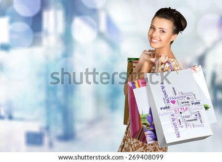Shopping. Beautiful young woman with her shopping bags - stock photo