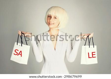 Shopping beauty woman holding shopping bags.Sale.Beautiful happy girl - stock photo