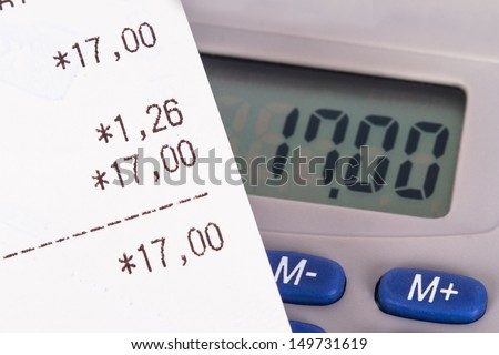 Shopping bill with calculator. - stock photo