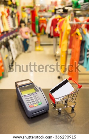 Shopping Card With Credit Card Machine In The Store - stock photo