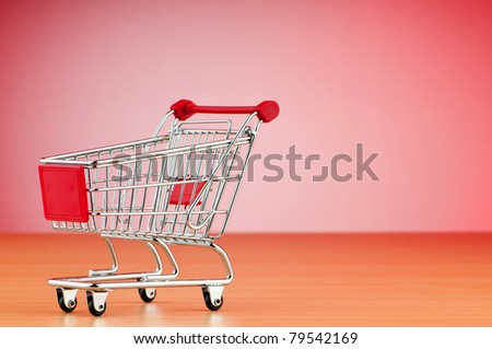 Shopping cart against the  background - stock photo
