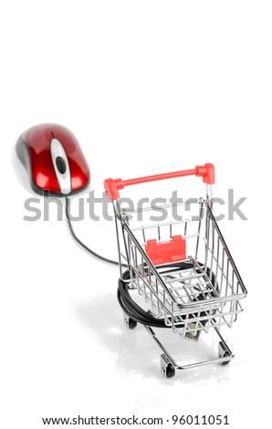 Shopping cart and computer mouse - stock photo