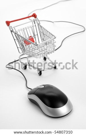Shopping Cart and Computer Mouse, concept of online shopping - stock photo