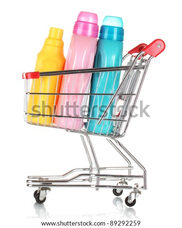 Shopping cart and detergent isolated on white - stock photo