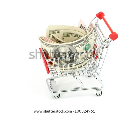 Shopping cart and dollars on the white - stock photo