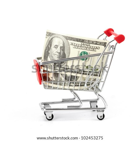 Shopping cart and dollars on the white