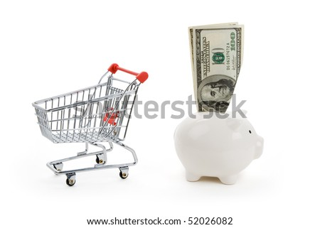 Shopping cart and Piggy bank, business concept, conflict between savings and expenses