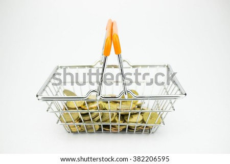 Shopping Cart Concept: Miniature Shopping Basket with Coins inside - stock photo