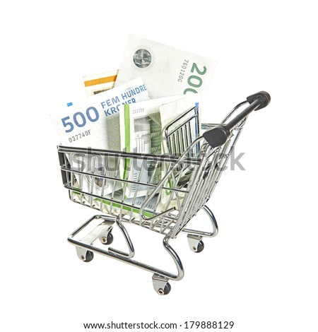 Shopping cart filled with danish bills in different values - stock photo