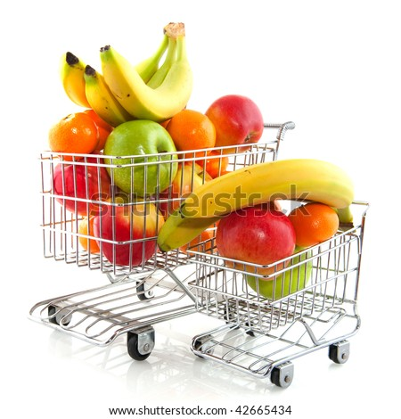 Shopping cart from the supermarket filled with fresh fruit