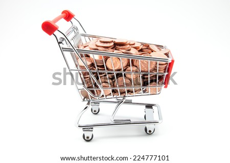 shopping cart full of coins - stock photo
