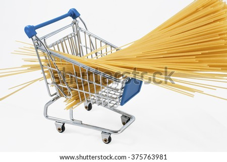 Shopping cart full of raw spaghetti (isolated on white) - stock photo