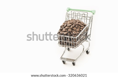 Shopping cart full of roasted coffee beans. - stock photo