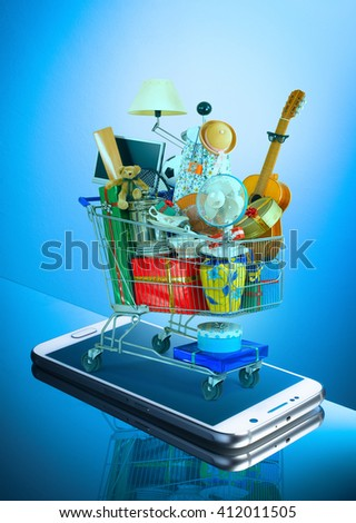 shopping cart full of things purchased online by mobile phone - stock photo