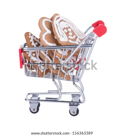 Shopping Cart Full With Gingerbread Cookies Isolated On White