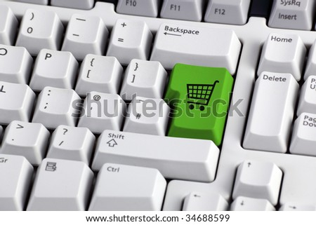 Shopping cart icon button on the enter key of a computer keyboard - stock photo
