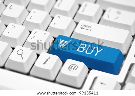Shopping cart icon button on the key of a computer keyboard