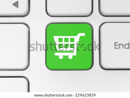 Shopping cart icon on green keyboard key - stock photo