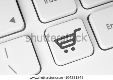 Shopping cart icon on keyboard key - stock photo
