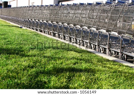 Shopping Cart in Parking Lot - stock photo